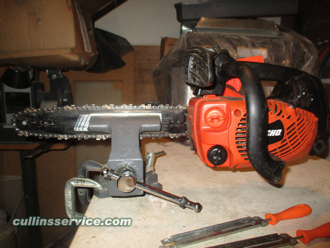 How to Sharpen a Chainsaw place chainsaw in vise side view Cullins Service
