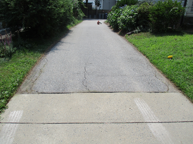 Cullins Service Landscapers finish the cleaning of driveway before sealing