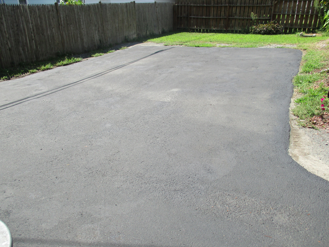 Full view of back Side of driveway after Cullins Service cleaned, filled cracks and sealed the driveway