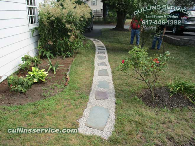 Cullins Service Landscapers checking out the peastone slate stone path