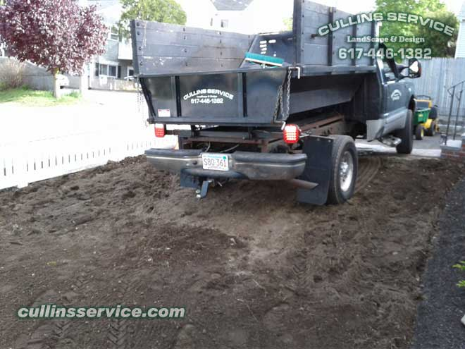 And the ford F350 is back with a load of organic compost loam.