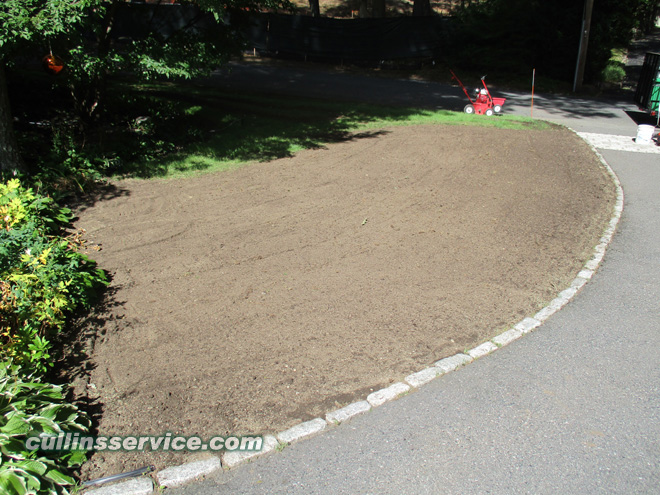 We are prepping the ground w/ loam and fertilizer to grow strong healthy grass