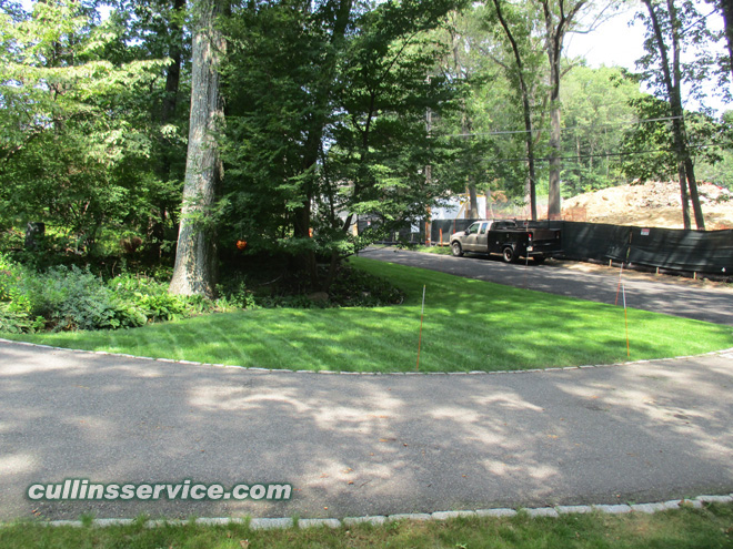 Lawn Installation seeding lawn care in Wellesley, Ma is complete